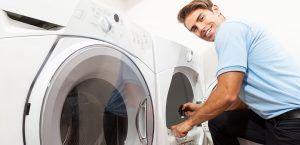 Dryer vent cleaning service technician performing clothes dryer inspection