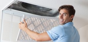 HVAC maintenance technician performing AC tune up