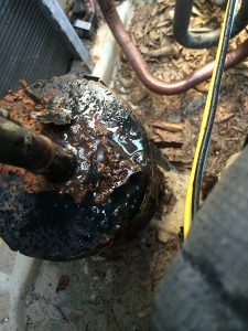 Rusted and Leaking Refrigerant Accumulator