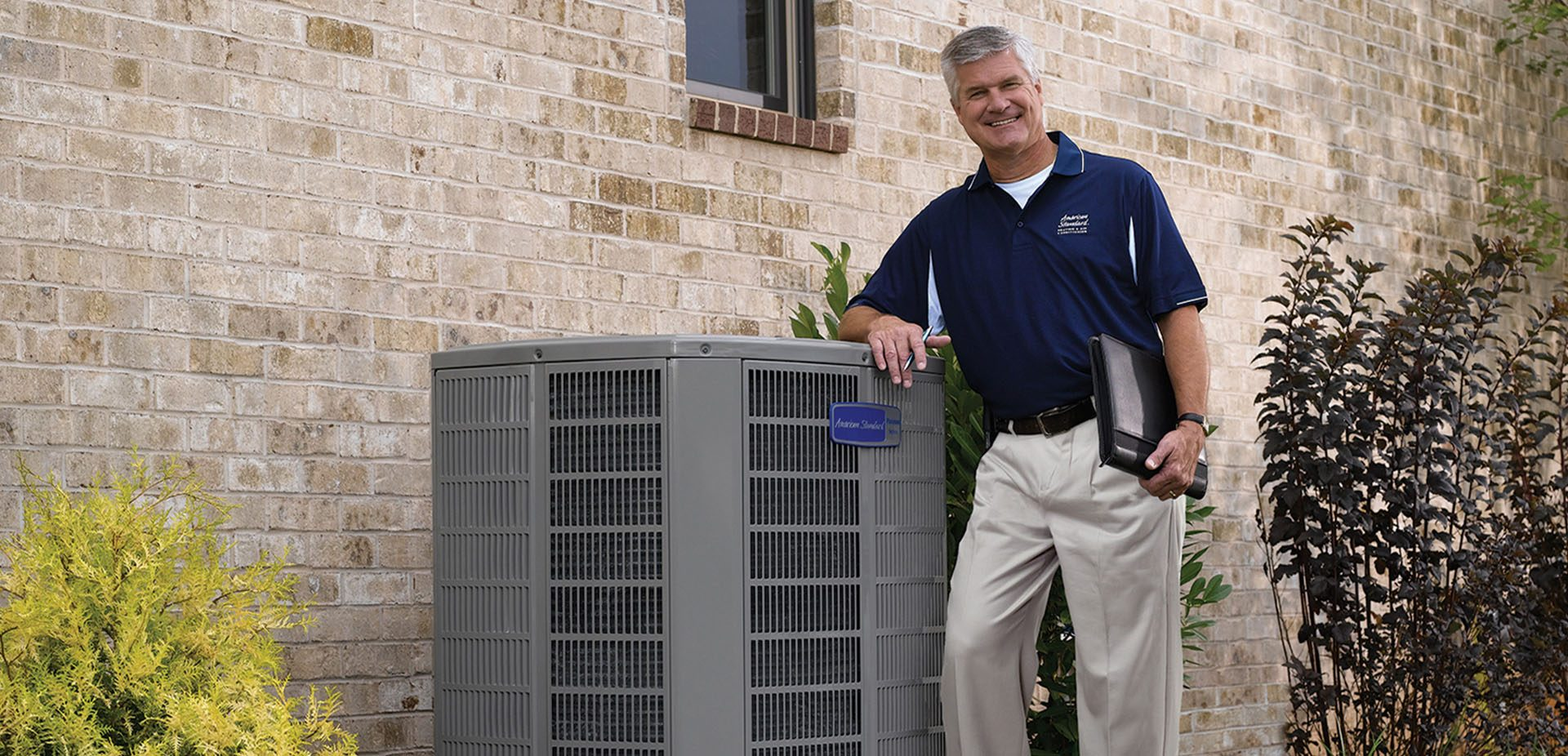 HVAC contractor and business owner with AC unit